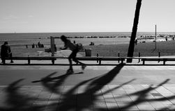 Person Skating on Road in Grayscale Photography Royalty Free Stock Photography