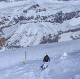 A person skiing on Mt. Titlis in Switzerland Stock Photo