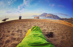 Person sleeping on beach,Cirali Royalty Free Stock Photo