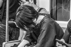 Person Sleeping On The Metro en Osaka Japan imagen de archivo