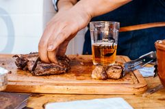 Person Slicing Grilled Meat Royalty Free Stock Image