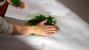 Person smears paint paper stock video