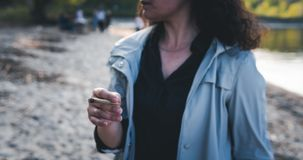 The person smoking marijuana joint outdoors royalty free stock photography