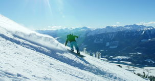 Person snowboarding on snowy mountain. Slope stock footage