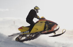 Person on snowmobile. Side view of person on snowmobile in midair jump Stock Photography