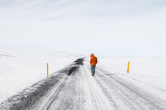 Person on snowy road Royalty Free Stock Images