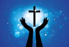 Person som ber eller tillber till helgedomkorset eller det Jesus diagrammet Arkivbild