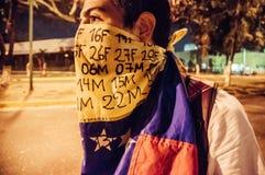 Person som protesterar i Venezuela Arkivbild