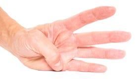 Person som visar fyra fingrar Arkivbild