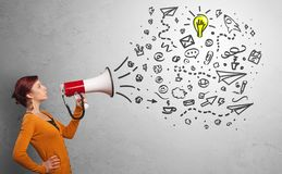 Person speaking in loudspeaker with ideas concept. Person holding megaphone and yelling ideas conceptn royalty free stock photos