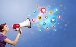 Person speaking in loudspeaker with social media concept. Person holding megaphone and yelling with social media concept royalty free stock photo