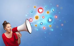 Person speaking in loudspeaker with social media concept stock photo