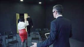 Person speaking during people walk away stock video