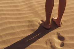 Person Stand on Sand royalty free stock image