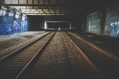 Person Standing Between 2 Train Rails Royalty Free Stock Photography