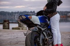 Person Standing Beside Blue Black and White Sports Bike during Day Time Royalty Free Stock Photography