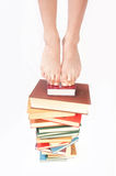 Person standing  of books Royalty Free Stock Photography