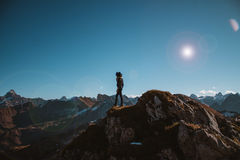 Person Standing on Brown Mountain Under Sunny Sky Stock Photography