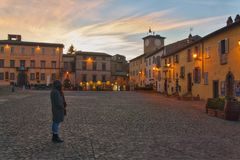Standing alone in an old cobblestone courtyard. royalty free stock photography