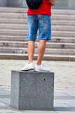Person standing on a cube Royalty Free Stock Photos