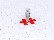 Person standing on different puzzle piece Royalty Free Stock Photography