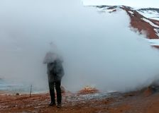 Person standing in fog on a hill stock photography