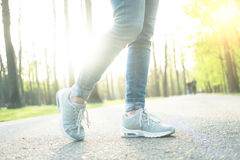 Person standing in gray sporty gumshoes Royalty Free Stock Photos
