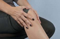Knee pain in close up stock image