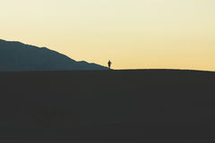Person Standing on Mountain during Daytime Stock Image
