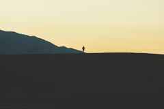 Person Standing on Mountain during Daytime Stock Photo