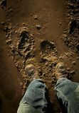 Person Standing In Mud. Low Section Of Person Standing In Mud Royalty Free Stock Images