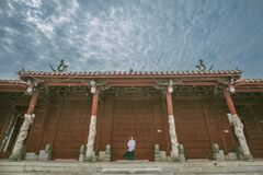 Person Standing Near Red Gate Stock Images