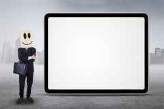 Person standing next to board outdoors Stock Photography