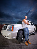 Person standing next to an SUV Stock Photography