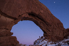Person standing in North Window arch at night in Winter royalty free stock photos