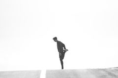 Person Standing on One Leg Black and White Photo Royalty Free Stock Images