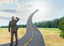 Person standing on roadway going up as arrow Royalty Free Stock Photo
