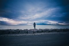 Person Standing on the Rocks Stock Images