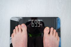 Person Standing On Weighing Scale royaltyfri fotografi