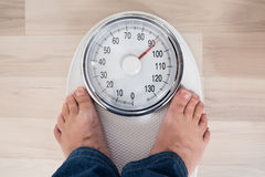 Person Standing On Weighing Scale Stock Image