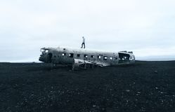 Person Standing on Wrecked Plane Stock Photo