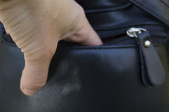 A Person Stealing Purse From Handbag. 