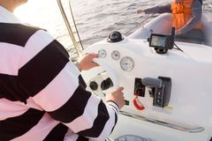 Person steering boat Royalty Free Stock Photography