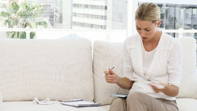 Person stressed with so many bills to pay Stock Photography