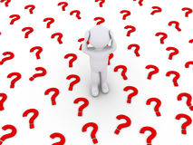 Person is stressed by many question mark symbols Royalty Free Stock Photography