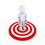 Person is on the success spot. 3d person is standing at the center of a target Stock Photos