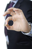 Person in a suit holding a coin Royalty Free Stock Images