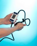 Person supervising blood pressure by tonometer Royalty Free Stock Photos