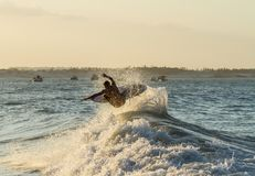 Person Surfboarding royalty free stock photos