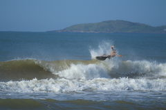 Person Surfboarding on Ocean during Daytime Royalty Free Stock Image